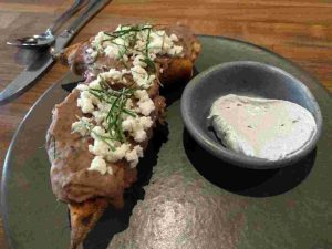 Molletes from Taco Maria which are open faced sandwiches with refried bean spread topped with queso freso